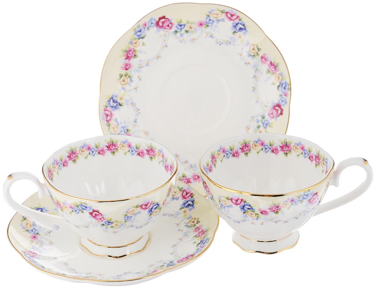 Набор чайных пар Elan Gallery Гирлянда из роз, 4 предмета530037Набор чайных пар Elan Gallery Гирлянда из роз состоит из 2 чашек и 2 блюдец. Предметы набора выполнены из высококачественной керамики и оформлены изящным изображением цветочных узоров. Яркий дизайн, несомненно, придется вам по вкусу. Набор чайных пар Elan Gallery Гирлянда из роз украсит ваш кухонный стол, а также станет замечательным подарком к любому празднику. Объем чашки: 250 мл. Диаметр чашки (по верхнему краю): 10 см. Высота чашки: 6,5 см. Диаметр блюдца: 16 см. Высота блюдца: 2 см.
