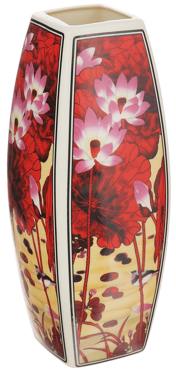 Ваза Elan Gallery Цветок лотоса, высота 21 см501909Декоративная ваза Elan Gallery Цветок лотоса украсит ваш интерьер и будет прекрасным подарком для ваших близких! Изделие выполнено из высококачественного фарфора и оформлено цветочным рисунком. Оригинальный дизайн наполнит ваш дом праздничным настроением. Изделие имеет подарочную упаковку, поэтому станет желанным подарком для ваших близких! Размер по верхнему краю: 5,2 см х 5,2 см. Размер дна: 5,3 см х 5,3 см. Высота вазы: 21 см.