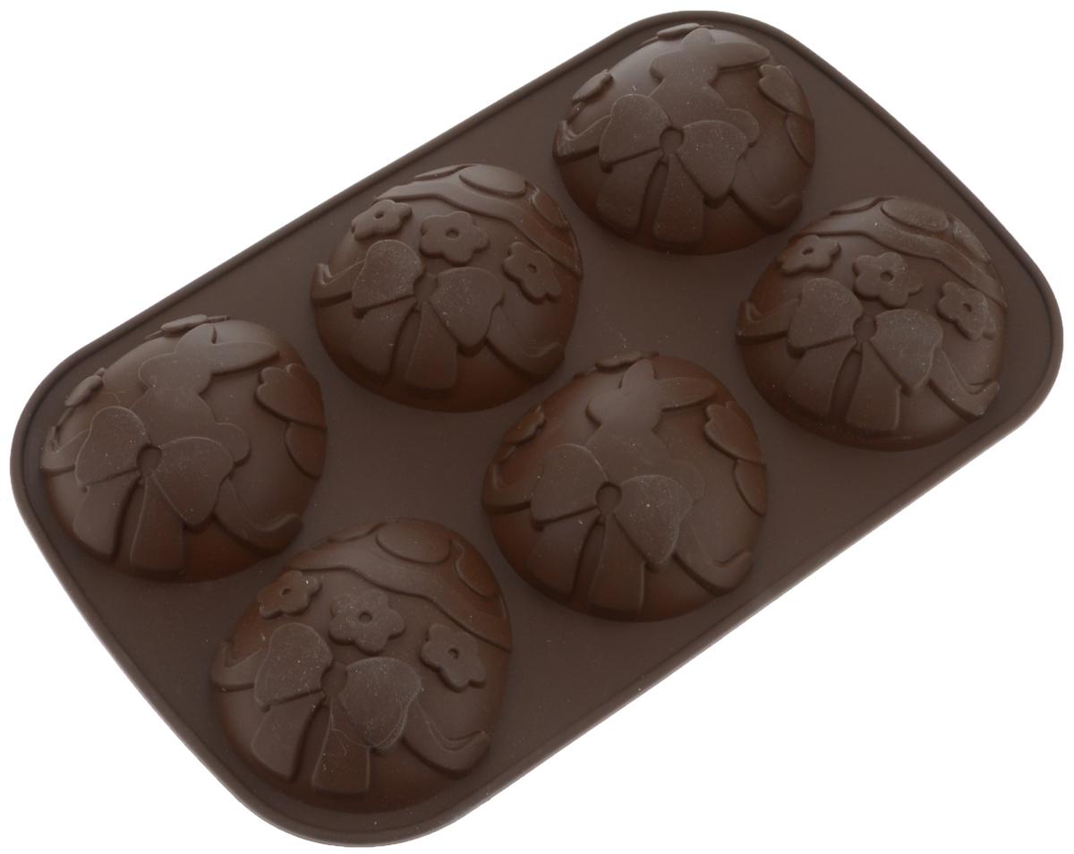 Форма для выпечки Tescoma Delicia Silicone, цвет: коричневый, 6 ячеек. 629346629346_коричневыйФорма Tescoma Delicia Silicone будет отличным выбором для всех любителей выпечки. Благодаря тому, что форма изготовлена из силикона, готовую выпечку или мармелад вынимать легко и просто. Изделие выполнено в форме прямоугольника, внутри которого расположены 6 ячеек в форме пасхальных яиц. Форма прекрасно подойдет для выпечки небольших кексов. С такой формой вы всегда сможете порадовать своих близких оригинальной выпечкой. Материал изделия устойчив к фруктовым кислотам, может быть использован в духовках, микроволновых печах, холодильниках и морозильных камерах (выдерживает температуру от -40°C до 230°C). Антипригарные свойства материала позволяют готовить без использования масла. Можно мыть и сушить в посудомоечной машине, охлаждать в холодильнике. При работе с формой используйте кухонный инструмент из силикона - кисти, лопатки, скребки. Не ставьте форму на электрическую конфорку. Не разрезайте выпечку прямо в форме. Общий размер формы:...