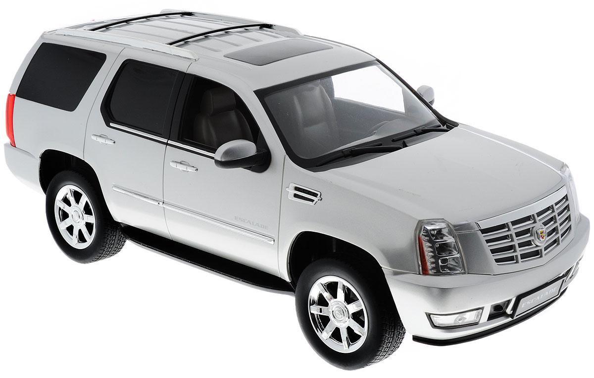 Rastar Радиоуправляемая модель Cadillac Escalade цвет серебристый28400_серебристыйРадиоуправляемая модель Rastar Cadillac Escalade станет первым внедорожником вашего малыша. Это точная копия настоящего авто в масштабе 1:14. Юные гонщики оценят эту машину за прекрасные технические характеристики и полную свободу передвижений в любую сторону. Моделью легко управлять и любая гонка принесет удовольствие. Управление машинкой происходит с помощью удобного пульта. Автомобиль двигается вперед и назад, поворачивает направо, налево и останавливается. Имеются световые эффекты. Автомобиль изготовлен из пластика с металлическими элементами. Колеса игрушки прорезинены и обеспечивают плавный ход, машинка не портит напольное покрытие. Пульт управления работает на частоте 40 MHz. Радиоуправляемые игрушки способствуют развитию координации движений, моторики и ловкости. Ваш ребенок часами будет играть с моделью, придумывая различные истории и устраивая соревнования. Машина работает от пяти батареек типа АА (не входят в комплект). Для работы пульта управления...