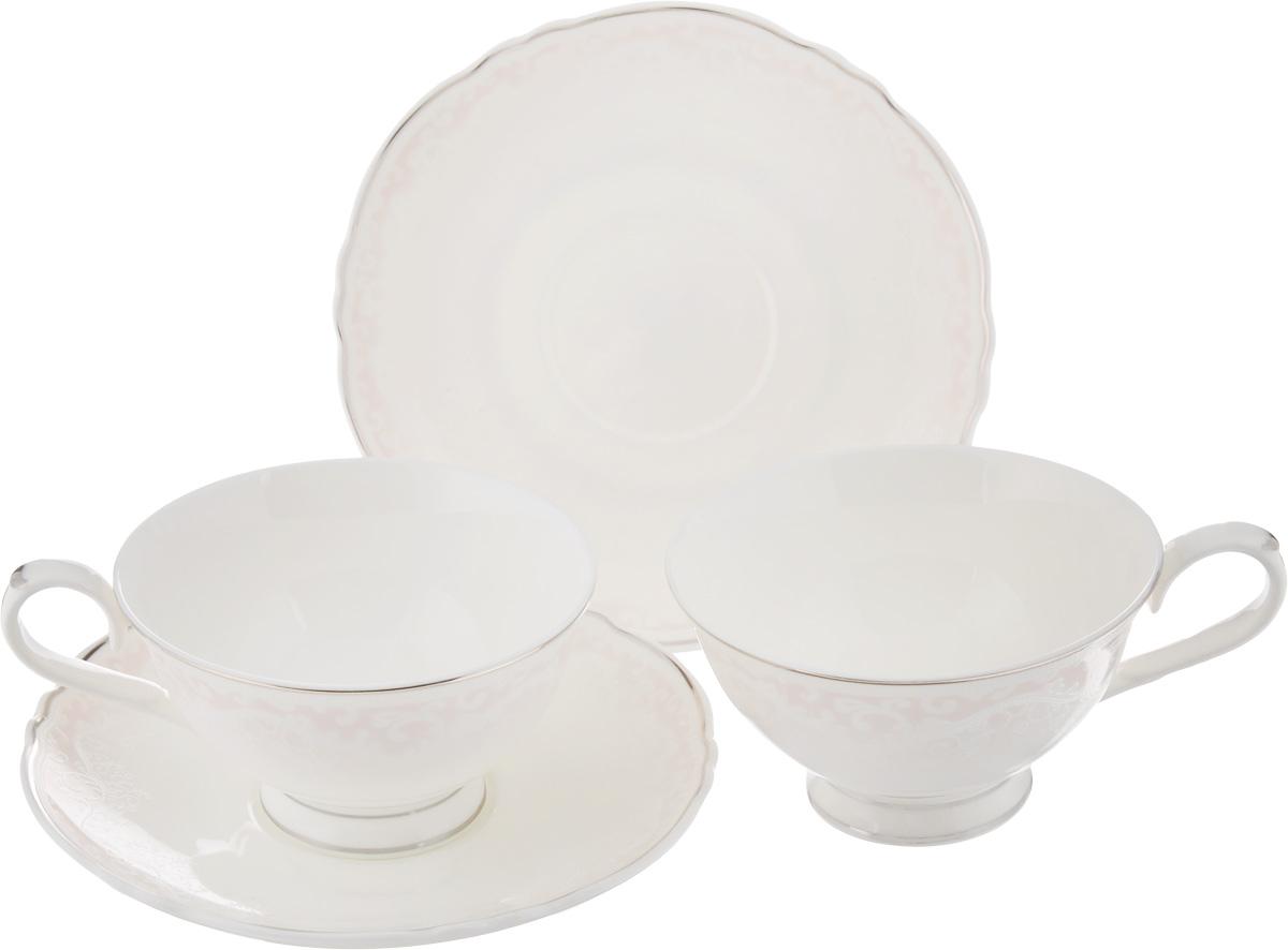 Набор чайный Elan Gallery Розовый шик, 4 предмета530028Чайный набор Elan Gallery Розовый шик состоит из 2 чашек и 2 блюдец, изготовленных из высококачественной керамики. Предметы набора декорированы серебристой окантовкой и нежными узорами. Чайный набор Elan Gallery Розовый шик украсит ваш кухонный стол, а также станет замечательным подарком друзьям и близким. Набор упакован в подарочную коробку с атласной подложкой. Не рекомендуется применять абразивные моющие средства. Не использовать в микроволновой печи. Объем чашки: 220 мл. Диаметр чашки по верхнему краю: 10,5 см. Высота чашки: 6 см. Диаметр блюдца: 15,5 см.