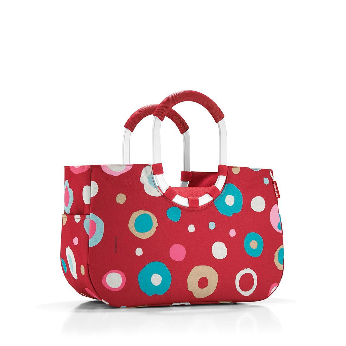 Сумка женская Reisenthel, цвет: темно-красный, голубой, розовый. OS3048OS3048Практичная женская сумка Reisenthel изготовлена из текстиля и оформлена оригинальным принтом. Сумка имеет одно отделение, внутри которого находится прорезной карман на застежке-молнии. Снаружи, по боковым сторонам сумки расположены накладные открытые карманы. Изделие оснащено съемным отделением на застежке-молнии, которое пристегивается к сумке с помощью хлястиков с кнопками. Съемное отделение снаружи дополнено прорезным карманом на застежке-молнии и накладным открытым кармашком. Сумка оснащена двумя алюминиевыми ручками с прорезиненными накладками, которые фиксируются с помощью липучек. Основание изделия защищено от повреждений пластиковыми ножками.