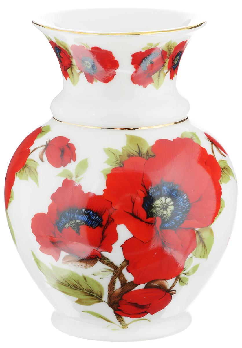 Ваза Elan Gallery Маки, высота 14 см740029Миниатюрная ваза Elan Gallery Маки, выполненная из высококачественного фарфора, украсит ваш интерьер и станет желанным подарком для ваших близких! Изделие подойдет для небольших букетов цветов или сухоцветов. Оригинальный дизайн вазы наполнит ваш дом праздничным настроением. Диаметр вазы (по верхнему краю): 7,5 см. Диаметр основания вазы: 6 см. Высота вазы: 14 см.