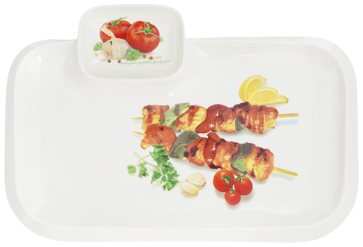 Блюдо для шашлыка Elan Gallery Шашлык, с соусницей, 35 х 24 см101191Сервировочное блюдо Elan Gallery Шашлык, изготовленное из керамики, идеально подойдет для подачи шашлыка на стол, а отделение для соуса поможет избежать использования дополнительной посуды. Это блюдо можно использовать для сервировки не только шашлыка, но и овощей, креветок, хлеба и других продуктов. Оно станет отличным дополнением к вашему кухонному инвентарю и подчеркнет прекрасный вкус хозяйки. Не рекомендуется применять абразивные моющие средства. Не использовать в микроволновой печи. Размер блюда (по верхнему краю): 35 х 24 см. Размер соусницы: 10 х 7,5 см.
