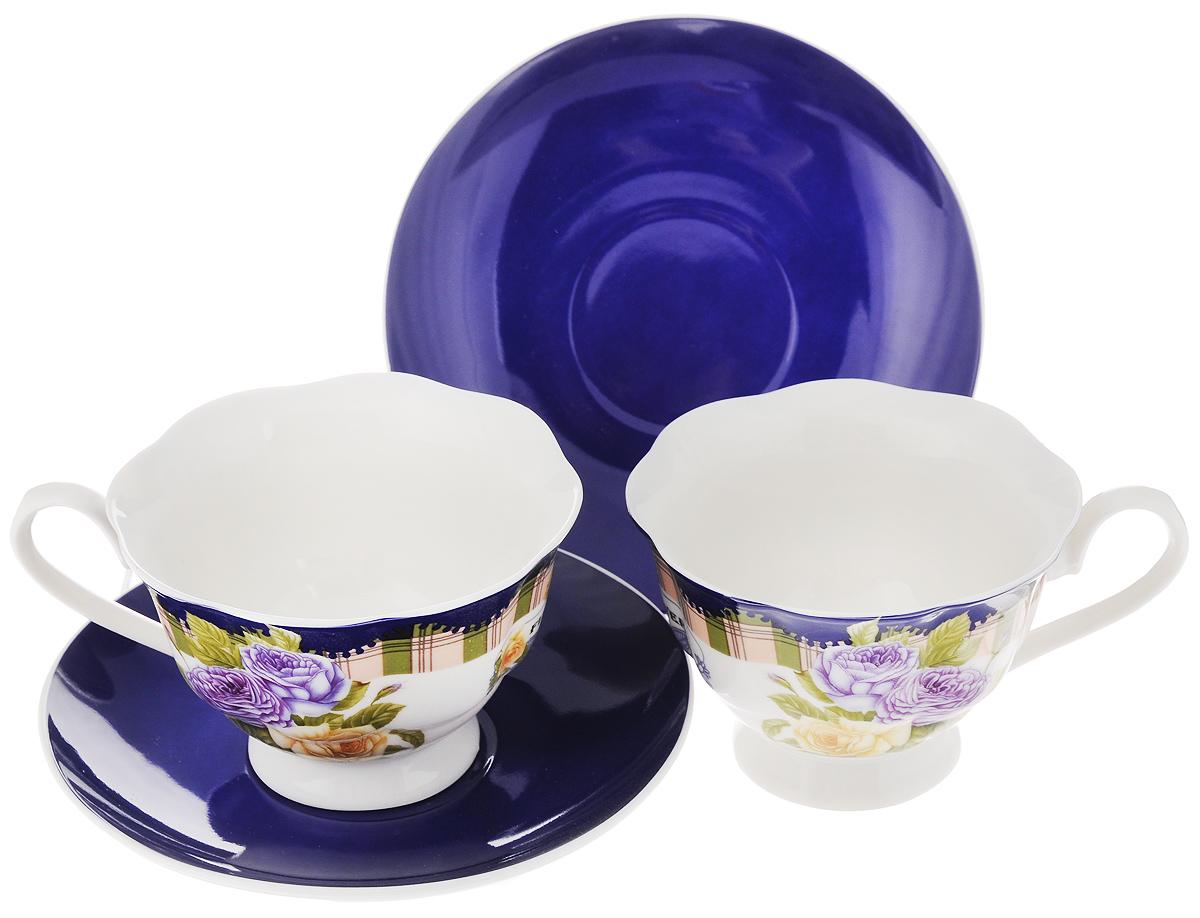 Набор чайный Loraine Розы, цвет: синий, 4 предмета23002_синийЧайный набор Loraine состоит из двух чашек и двух блюдец. Изделия выполнены из высококачественного костяного фарфора, чашки оформлены красивым цветочным рисунком, а блюдца однотонные. Такой набор красиво дополнит сервировку стола к чаепитию. Благодаря изысканному дизайну и качеству исполнения, такой набор станет замечательным подарком для ваших друзей и близких. Набор упакован в подарочную коробку в форме сердца, задрапированную белой атласной тканью. Объем чашки: 200 мл. Диаметр чашки (по верхнему краю): 9,5 см. Высота чашки: 6,5 см. Диаметр блюдца: 14 см.