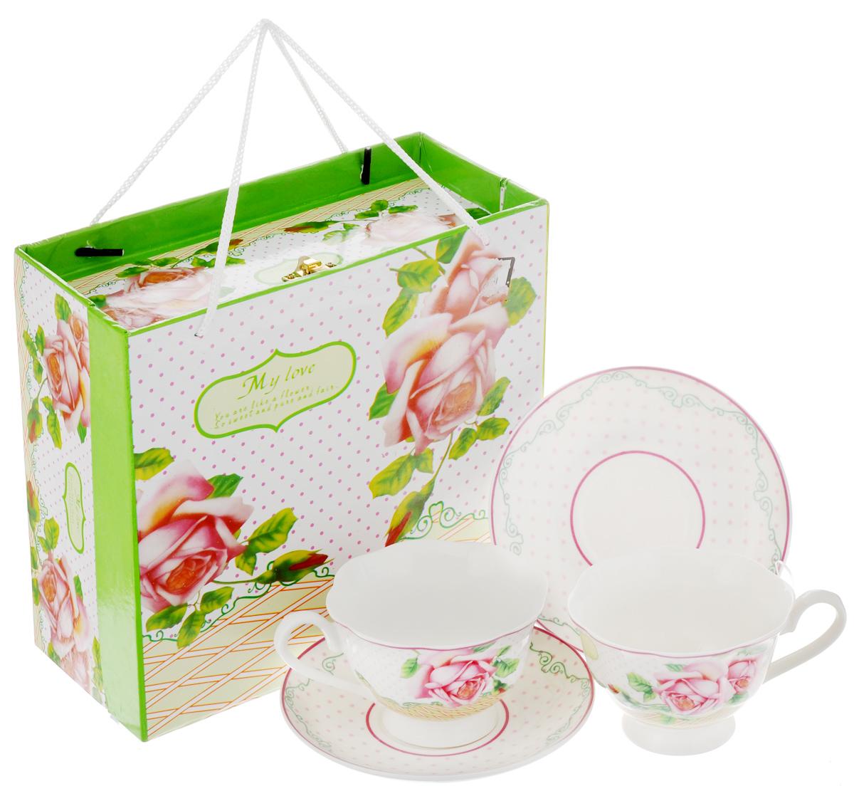Набор чайный Loraine Розы, 4 предмета. 2302323023Чайный набор Loraine Розы состоит из двух чашек и двух блюдец. Изделия выполнены из высококачественного костяного фарфора и оформлены ярким изображением цветов. Изящный дизайн и красочность оформления придутся по вкусу и ценителям классики, и тем, кто предпочитает утонченность и изысканность. Чайный набор - идеальный и необходимый подарок для вашего дома и для ваших друзей в праздники, юбилеи и торжества. Он также станет отличным корпоративным подарком и украшением любой кухни. Чайный набор упакован в подарочную коробку прямоугольной формы из плотного цветного картона, с замочком и веревочными ручками. Внутренняя часть коробки задрапирована белым атласом. Объем чашки: 200 мл. Диаметр чашки (по верхнему краю): 9,5 см. Высота чашки: 6,5 см. Диаметр блюдца: 14 см.