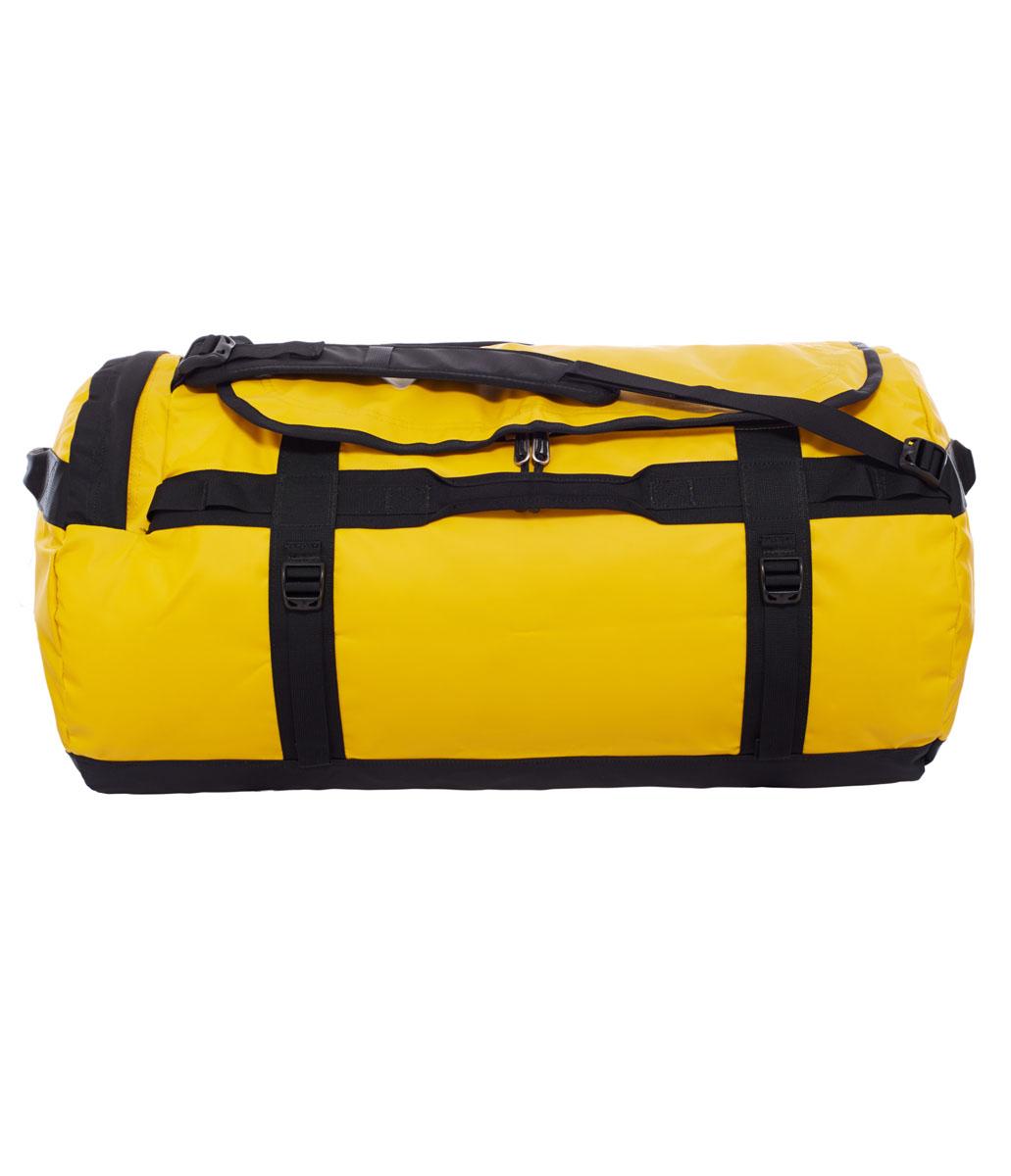 Сумка дорожная The North Face Base Camp Duffel - L, цвет: желтый. T0CWW1ZU3T0CWW1ZU3Знаменитый баул, который ценят по всему миру за его надежность. Новые детали включают боковой карман на молнии для телефона или необходимых в пути документов, улучшенные эргономичные плечевые лямки, новые мягкие боковые ручки, которые позволяют с удобством переносить или тащить тяжелые грузы. В то же время, проверенная временем конструкция из нейлона баллистик все так же надежна, как и прежде.