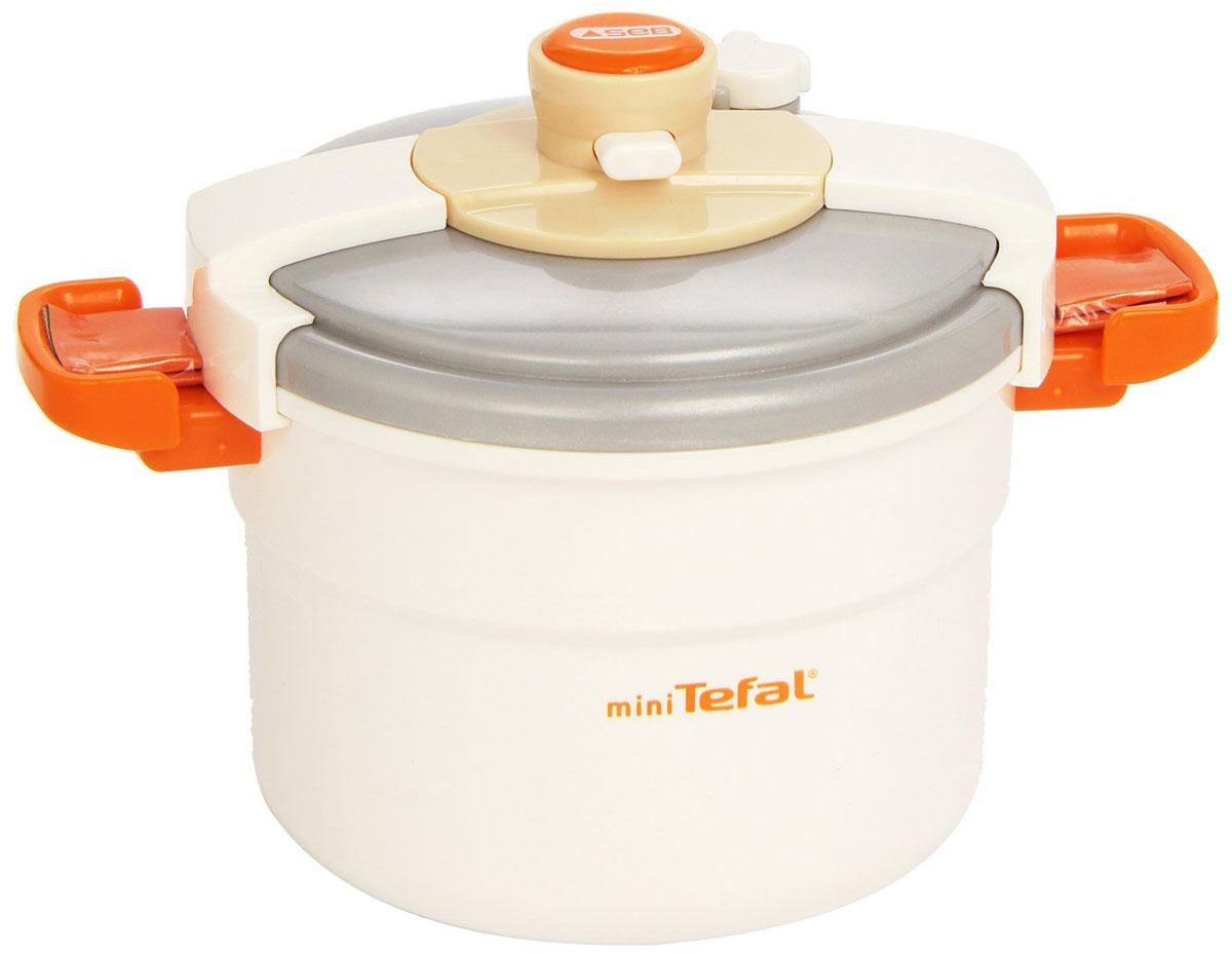Smoby Скороварка Tefal24549Скороварка Tefal, изготовленная из пластика представляет собой уменьшенную копию настоящей скороварки. Игрушечная скороварка Tefal будет отличным дополнением к кухне маленькой хозяйки. Также она позволит разнообразить процесс приготовления пищи. В скороварку можно положить игрушечные овощи и продукты. А чтобы при варке крышка не открывалась, для этого имеется специальная функция: при нажатии на кнопку блокируется крышка скороварки. На крышке имеется специальный рычажок, который поворачивается с легким звуком треска. Порадуйте свою малышку таким замечательным подарком.