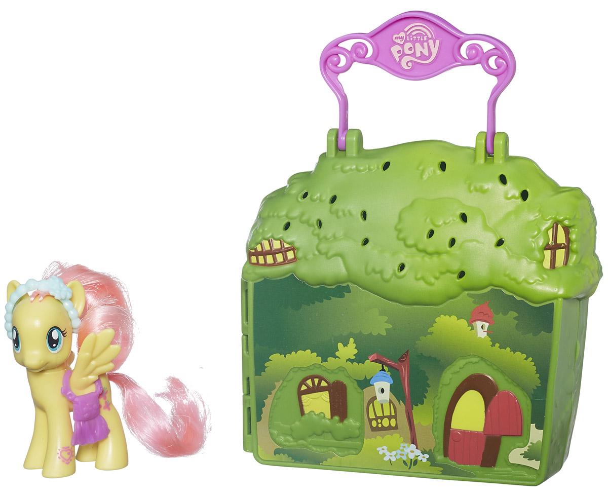 My Little Pony Набор фигурок Магазин одеждыB3604_В5391Набор фигурок My Little Pony Магазин одежды станет отличным подарком для вашей малышки! Набор включает в себя фигурку пони Fluttershy, магазин одежды в виде раскладывающегося чемоданчика с ручкой, горшок с цветком, лейку, две бабочки, а также два наряда для пони. Сама фигурка держит элегантную сумочку, а ее голова украшена изящным ободком. Мягкую гриву Fluttershy можно расчесывать и создавать разнообразные прически. На ножке фигурки есть специальный символ, который позволит разблокировать игру для смартфона (скачивается отдельно). Малышка будет часами играть с этим набором, придумывая разные истории.