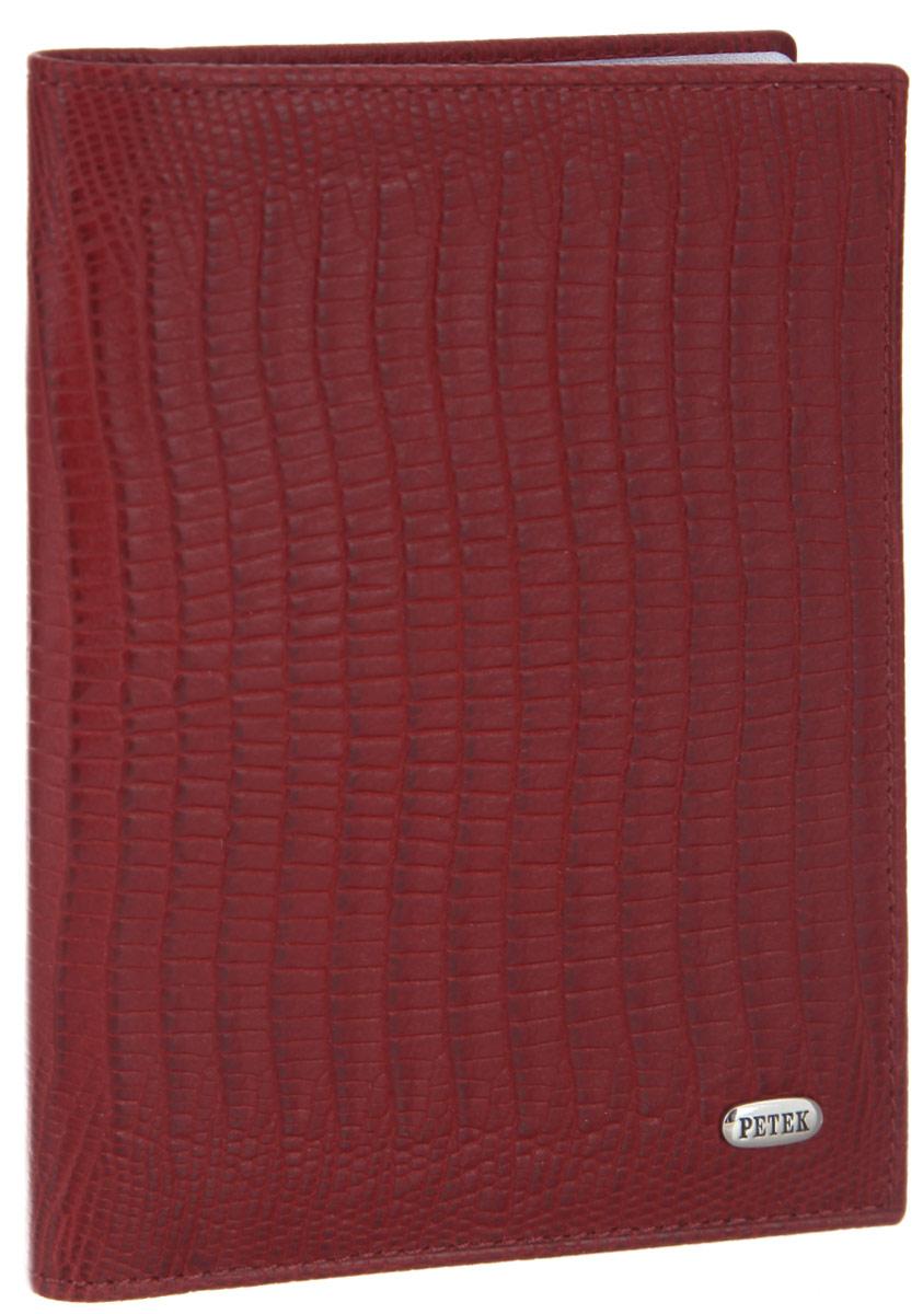 Обложка для автодокументов женская Petek 1855, цвет: красный. 584.041.10584.041.10 RedСтильная обложка для автодокументов Petek 1855 изготовлена из натуральной кожи с декоративным фактурным тиснением под кожу рептилии, оформлена металлической пластиной с символикой бренда. Внутри изделия расположены четыре прорезных кармашка для пластиковых карт, сетчатый карман и вкладыш, включающий в себя шесть файлов под автодокументы. Изделие поставляется в фирменной упаковке. Практичная и удобная модель обложки предназначена для тех, кто предпочитает все необходимое хранить в одном месте.