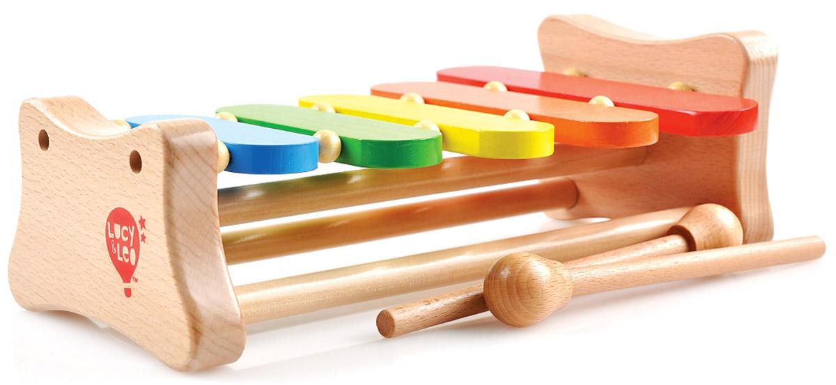 Lucy&Leo Музыкальный инструмент КсилофонLL107Яркий деревянный ксилофон позволит вашему ребенку устроить маленький музыкальный концерт! С удобными молоточками ваше чадо легко сможет выстукивать разные мелодии. Игрушка развивает музыкальный слух, координацию и цветовую память.
