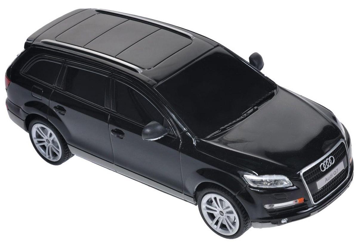 Rastar Радиоуправляемая модель Audi Q7 цвет черный масштаб 1:2427300_черныйВсе мальчишки, увлеченные автомобилями, больше всего мечтают, чтобы им дарили либо гоночные суперкары и болиды, либо внушительные внедорожники. Такие, как этот Audi Q7 от Rastar. Модель полностью повторяет знаменитый немецкий внедорожник, имеет официальную лицензию Audi и сертификат соответствия Ростеста. Впечатляющая дальность действия пульта обеспечивает возможность гонять машинку на дальние расстояния в просторных помещениях и на улице.