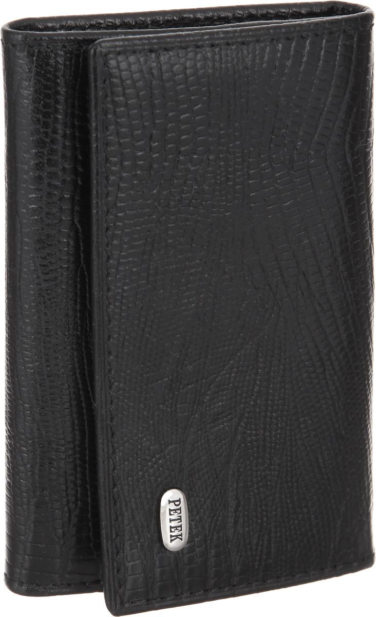 Ключница Petek 1855, цвет: черный. 505.041.01505.041.01 BlackСтильная ключница Petek 1855 изготовлена из натуральной высококачественной кожи с декоративным фактурным тиснением под кожу рептилии. Лицевая сторона изделия оформлена небольшой металлической пластиной с гравировкой в виде названия бренда. Изделие закрывается клапаном на кнопку. Внутри изделия расположены шесть крючков для ключей и кармашек на молнии. Изделие упаковано в коробку из плотного картона с логотипом фирмы. Ключница станет отличным подарком человеку, ценящему практичные и стильные вещи, а качество его исполнения представит такой подарок в самом выгодном свете.