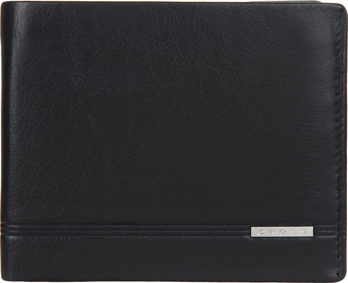 Кошелек мужской Cross, цвет: черный. AC018363-1AC018363-1Стильный мужской кошелек Cross изготовлен из натуральной кожи и оформлен металлической пластиной с символикой бренда. Изделие раскладывается пополам. Внутри расположены два прорезных потайных кармана, два отделения для купюр, четыре кармана для кредитных карт. Кошелек оснащен откидным блоком, который включает в себя два кармашка с прозрачными вставками и карман для пластиковой кары. Снаружи, на задней стороне, изделия расположен дополнительный прорезной кармашек. Изделие поставляется в фирменной упаковке. Практичный кошелек непременно подойдет к вашему образу, а также порадует простотой, стилем и функциональностью.