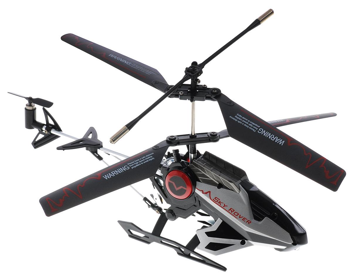 Auldey Вертолет на инфракрасном управлении Sky Rover цвет черныйYW860010Вертолет на инфракрасном управлении Auldey Sky Rover со встроенным гироскопом отлично подходит для полетов в закрытых помещениях и на улице в безветренную погоду. Гироскоп предназначен для курсовой стабилизации полета. Игрушка выполнена из прочного пластика с металлическими элементами и имеет два основных винта и один хвостовой. Вертолет стабилен в воздухе и легко управляется. Пульт управления позволяет вертолету летать вверх-вниз, вперед-назад и вращаться и останавливаться. А также вертолет оснащен системой голосового управления и световыми эффектами. Существует 17 голосовых команд. Вертолет распознает команды, которые вы ему проговариваете. Если вы понятно дали команду, вы услышите автоматический голос, который повторит вашу команду, и вертолет выполнит ее. Эта увлекательная игрушка понравится не только детям, но и взрослым, и подарит вам множество счастливых мгновений. Вертолет работает от встроенного аккумулятора, который можно заряжать...