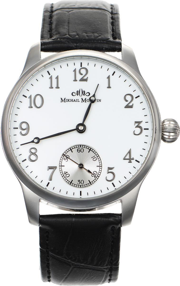 Часы наручные мужские Mikhail Moskvin, цвет: серебряный, черный. ST12822ST12822Элегантные мужские часы Mikhail Moskvin изготовлены из нержавеющей стали. Циферблат с выносной секундной стрелкой оформлен символикой бренда. Корпус часов имеет степень влагозащиты, равную 3 Bar, оснащен механическим механизмом, а также устойчивым к царапинам минеральным стеклом с сапфировым напылением. Задняя крышка выполнена из стекла, благодаря чему видно элементы механизма. Ремешок, выполненный из натуральной кожи с декоративным тиснением под кожу рептилии, застегивается на пряжку. Часы поставляются в фирменной упаковке. Часы Mikhail Moskvin подчеркнут отменное чувство стиля их обладателя.