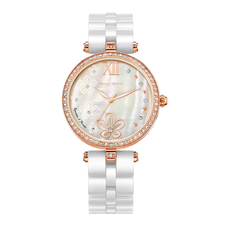 Наручные часы Mikhail Moskvin. 1195S18B21195S18B2Созданные угличскими часовщиками для прекрасных женщин, эти часы сочетает в себе элегантный дизайн и глубокое уважение к часовой традиции. Тонкий ободок из сверкающих стразов обрамляет перламутровый циферблат. На мерцающей поверхности на месте индикации часов - восхитительный орнамент из цветов и чередующиеся золотые и сверкающие круглые знаки. Золотые заостренные стрелки заполнены белой массой. Граненая заводная головка венчается блестящей сферой. Задняя крышка изготовлена из высококачественной нержавеющей стали. Высокоточный японский кварцевый механизм производства фирмы Miyota Sitizen оснащен часовой, минутной и секундной стрелками. Браслет комплектуется надежной и удобной в использовании застежкой-бабочкой. Бело-золотые тона модели придают ей воздушность и элегантность.