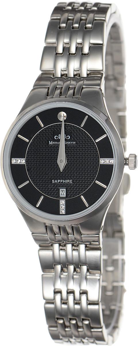 Часы наручные женские Mikhail Moskvin Elegance, цвет: серебряный, черный. L5001S0B1L5001S0B1Стильные женские наручные часы Mikhail Moskvin из серии Elegance изготовлены из высокотехнологичной гипоаллергенной нержавеющей стали. Для того чтобы защитить циферблат от повреждений в часах используется высокопрочное сапфировое стекло. Циферблат изделия оснащен гранеными стрелками, оформлен символикой бренда и стразами. Корпус часов оснащен кварцевым японским механизмом, степенью влагозащиты равной 3 Bar, а также календарем, показывающим число месяца. Браслет часов застегивается на замок-клипсу, который позволит с легкостью снимать и надевать часы. Часы упакованы в фирменную коробку и дополнительно в текстильную сумку с названием бренда. Часы Mikhail Moskvin подчеркнут характер и отменное чувство стиля их обладателя.