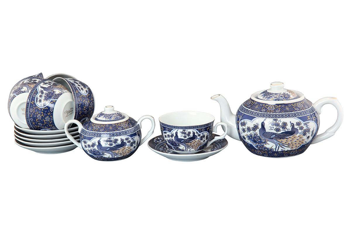 Чайный набор Elan Gallery Павлин, 14 предметов. 730501730501Чайный сервиз на 6 персон из традиционной коллекции Павлин синий - неотъемлемый атрибут чаепития и служит не только посудой, но и источником эстетического наслаждения. Изделие имеет подарочную упаковку, идеальный подарок для ваших близких! Чашки -250 мл., сахарница - 400 мл., чайник - 900 мл. Размеры: 60x110x95 мм, 140x140x20 мм.