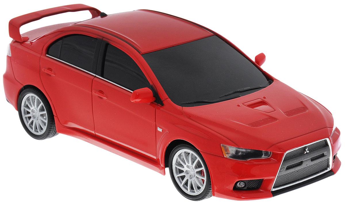 Welly Радиоуправляемая модель Mitsubishi Lancer Evolution X цвет красный84006Радиоуправляемая модель Welly Mitsubishi Lancer Evolution X обязательно привлечет внимание взрослого и ребенка и понравится любому, кто увлекается автомобилями. Маневренная и реалистичная уменьшенная копия Mitsubishi Lancer Evolution X выполнена в точной детализации с настоящим автомобилем в масштабе 1/24. Управление машинкой происходит с помощью пульта. Машинка двигается вперед и назад, поворачивает направо и налево. Имеются световые эффекты. Колеса игрушки прорезинены и обеспечивают плавный ход, машинка не портит напольное покрытие. Радиоуправляемые игрушки способствуют развитию координации движений, моторики и ловкости. Ваш ребенок часами будет играть с моделью, придумывая различные истории и устраивая соревнования. Порадуйте его таким замечательным подарком! Для работы машинки необходимо купить 3 батарейки напряжением 1,5V типа АА; для работы пульта - 2 батарейки напряжением 1,5V типа АА (не входят в комплект).