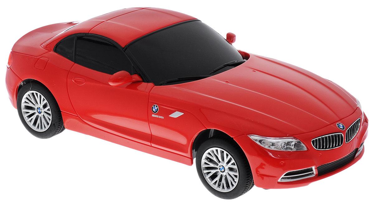 Rastar Радиоуправляемая модель BMW Z4 цвет красный масштаб 1:2439700_красныйРадиоуправляемая модель Rastar BMW Z4 - точная копия настоящего автомобиля, выполненная в масштабе 1:24. Модель привлечет к себе внимание не только детей, но и взрослых. Корпус автомобиля выполнен из пластика с металлическими элементами, колеса прорезинены. Движения автомобиля: вперед-назад, влево-вправо, остановка. Пульт управления работает на частоте 40 MHz. Радиоуправляемые игрушки способствуют развитию координации движений, моторики и ловкости. Ваш ребенок часами будет играть с моделью, придумывая различные истории и устраивая соревнования. Порадуйте его таким замечательным подарком! Машина работает от 3 батареек типа АА (не входят в комплект). Пульт управления работает от 2 батареек типа АА (не входят в комплект).