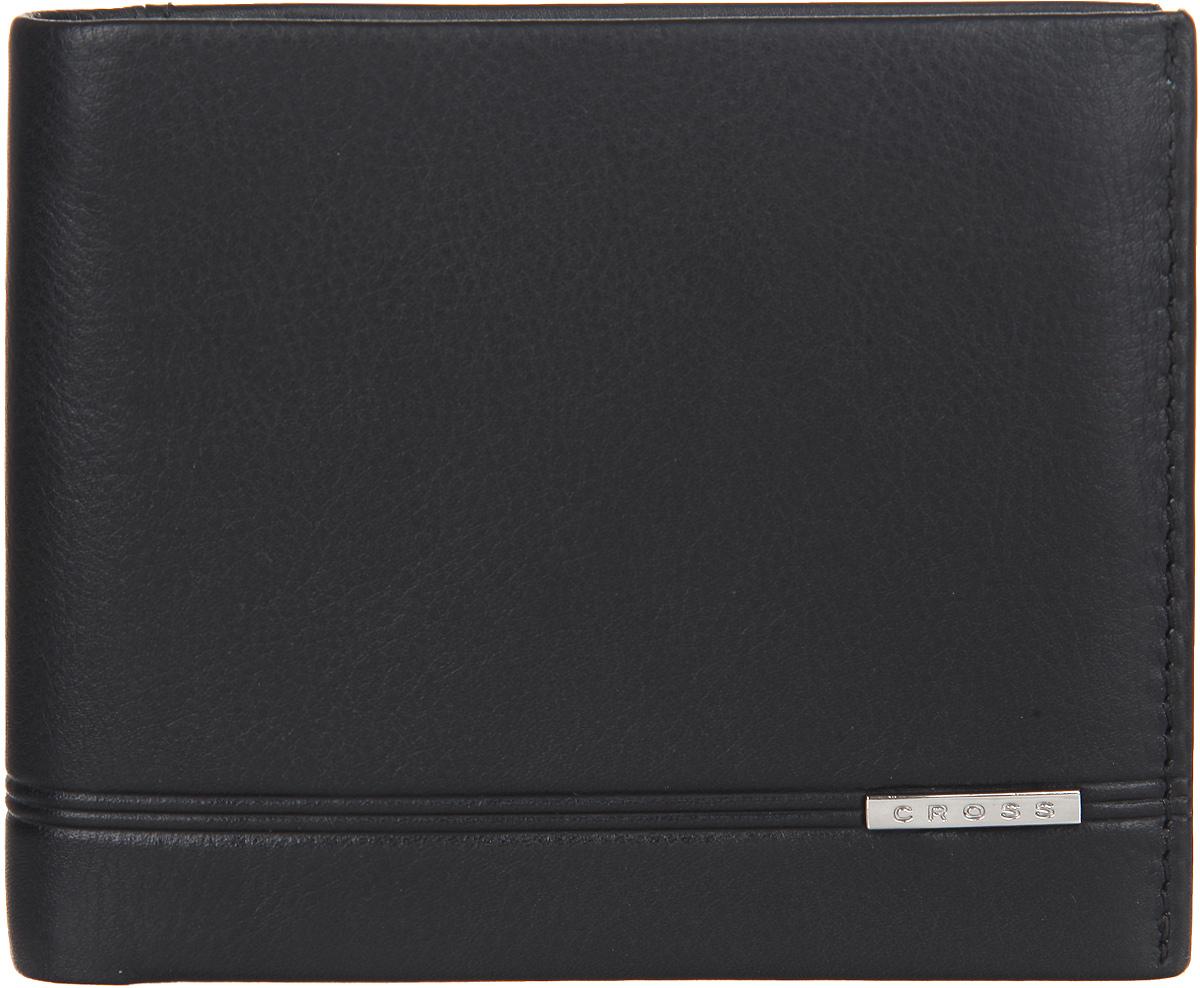 Кошелек мужской Cross, цвет: черный. AC018067-1AC018067-1Стильный мужской кошелек Cross изготовлен из натуральной кожи и оформлен металлической пластиной с символикой бренда. Изделие раскладывается пополам. Внутри расположены два прорезных потайных кармана, два отделения для купюр, три кармана для кредитных карт, отделение для монет, закрывающееся клапаном на кнопку. Снаружи, на задней стороне, изделия расположен дополнительный прорезной кармашек. Изделие поставляется в фирменной упаковке. Практичный кошелек непременно подойдет к вашему образу, а также порадует простотой, стилем и функциональностью.