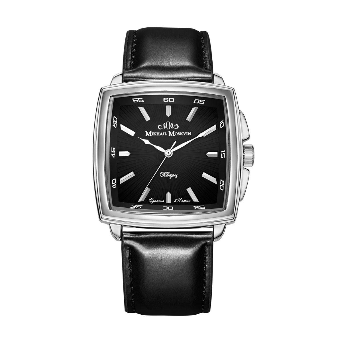 Часы мужские наручные Mikhail Moskvin, цвет: серебристый. 1039A1L51039A1L5Модель является достойным продолжателем элегантного стиля коллекции CLASSIC, выпущенной Угличским часовым заводом. В ней проявилась безграничность форм неповторимой часовой классики. Квадратный двухуровневый корпус шириной 43 мм со слегка выпуклыми боками дополнен небольшими ушками и скругленными предохранителями вокруг переводной головки и покрыт по современной технологии – ионным напылением стали. Поверхность черного циферблата гильоширована тонкими лучами, расходящимися от центра. Часовые индексы в виде стальных прямоугольных знаков продолжаются на скошенной рамке циферблаты обозначением позиций минут. Высокоточный японский кварцевый механизм, производства фирмы Seiko Epson, оснащен часовой, минутной и секундной стрелками. Срок службы элемента питания 2 года. Гладкий черный ремень со стальной застежкой - гарантируют комфорт и надежность.