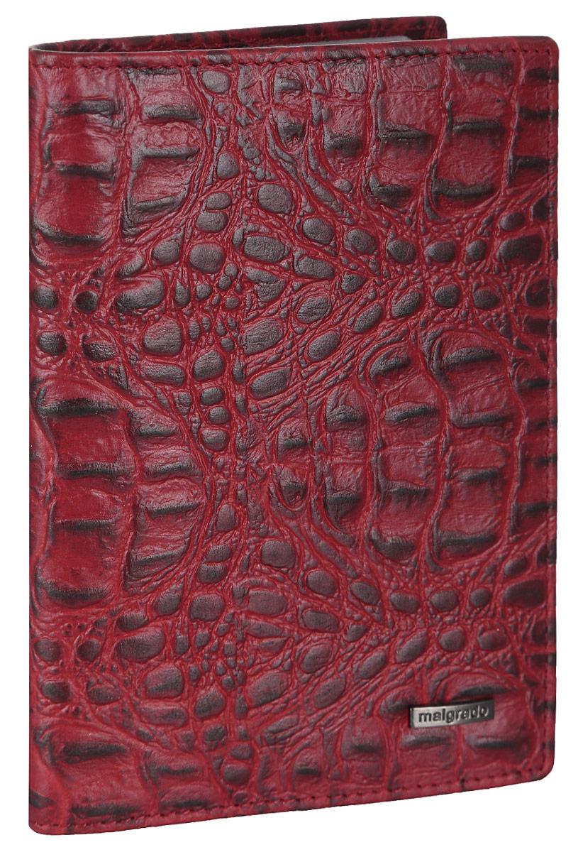 Обложка для документов женская Malgrado, цвет: красный. 54019-1-5080154019-1-50801Элегантная обложка для документов Malgrado выполнена из натуральной кожи с декоративным фактурным тиснением под кожу рептилии. Изделие оформлено металлической пластиной с гравировкой в виде символики бренда. Изделие может послужить как для хранения автодокументов, так и паспорта. Внутри содержится съемный блок из шести прозрачных файлов для автодокументов, также имеется пять кармашков для визиток или пластиковых карт. Обложка упакована в подарочную коробку с логотипом фирмы. Обложка поможет сохранить внешний вид ваших документов, защитит их от повреждений, а также станет стильным аксессуаром, который подчеркнет ваш образ.