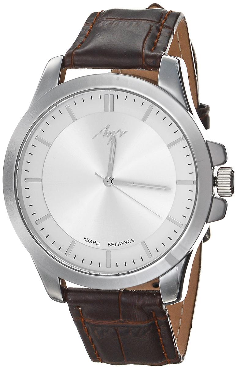 Часы наручные женские Луч Современная, цвет: серебряный, темно-коричневый. 729107282729107282Стильные женские часы Луч Современная изготовлены из нержавеющей стали и минерального стекла. Циферблат часов оформлен символикой бренда. Корпус часов имеет степень влагозащиты равную 3 Bar, оснащен кварцевым механизмом Miyota, а также дополнен устойчивым к царапинам минеральным стеклом. На стрелки нанесен светящийся состав. Практичная пряжка, дополняющая ремешок из натуральной кожи, позволит с легкостью снимать и надевать часы. Ремешок оформлен декоративным тиснением под кожу рептилии. Часы поставляются в фирменной упаковке. Часы Луч Современная подчеркнут изящность женской руки и отменное чувство стиля у их обладательницы.