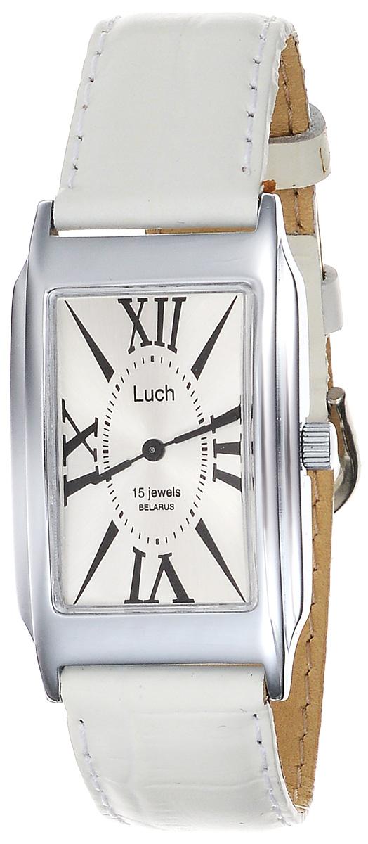 Часы наручные женские Луч Классическая коллекция, цвет: серебряный, белый. 7557117475571174Элегантные женские часы Луч Классическая коллекция изготовлены из металлического сплава с хромированной поверхностью и органического стекла. Циферблат часов оформлен символикой бренда. Механические часы имеют высокоточный механизм на 15 рубиновых камнях с противоударным устройством оси баланса. Ремешок часов выполнен из натуральной кожи с декоративным тиснением под кожу рептилии. Практичная пряжка, дополняющая ремешок, позволит с легкостью снимать и надевать часы. Часы поставляются в фирменной упаковке. Часы Луч Классическая коллекция подчеркнут изящность женской руки и отменное чувство стиля у их обладательницы.