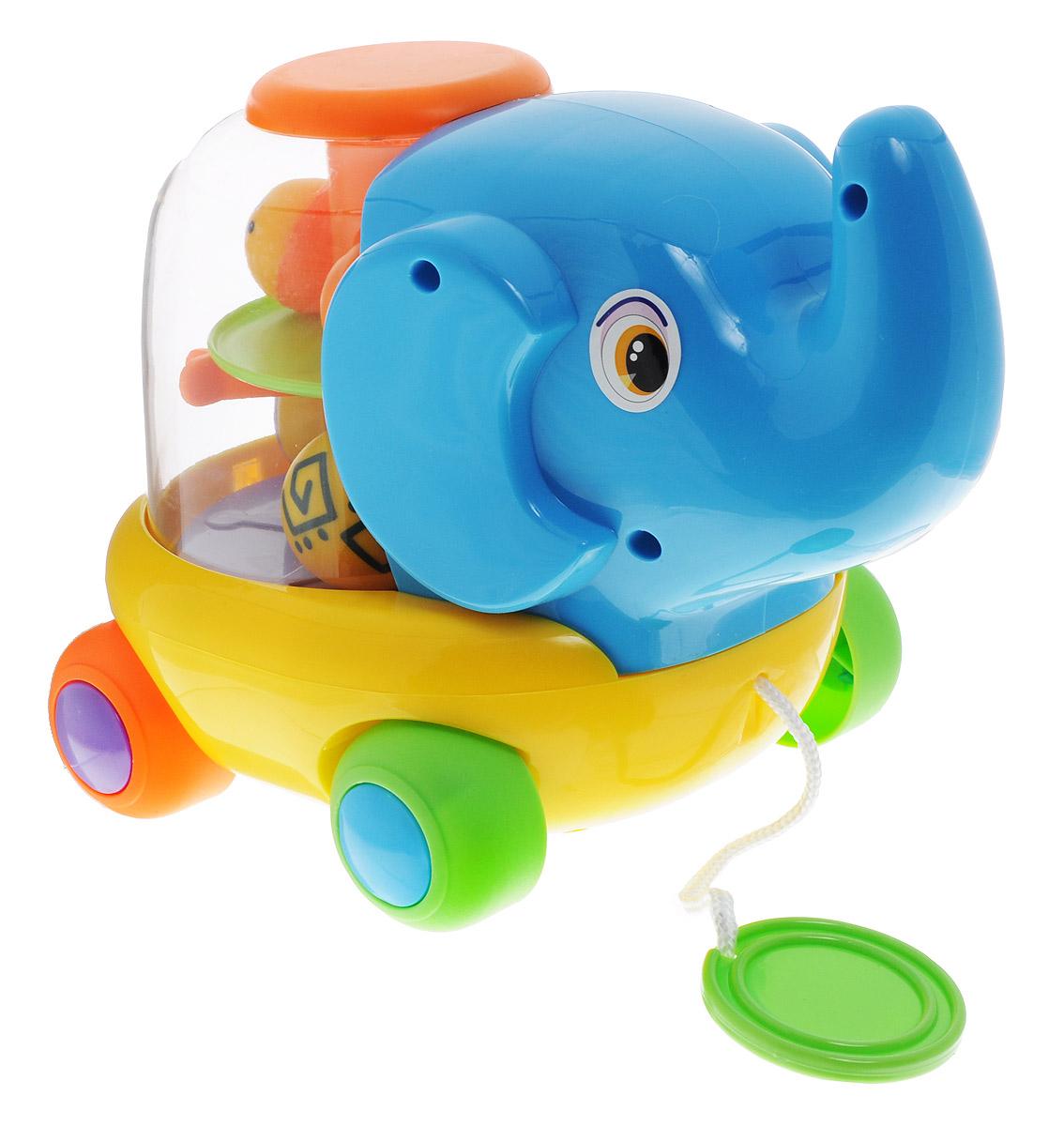 Simba Игрушка-каталка Слоник4018971Красочная игрушка-каталка Слоник понравится любому малышу. Игрушка изготовлена из высококачественного пластика ярких цветов, ее удобно катать маленькой ручкой. Теперь у вашего малыша будет настоящий слон, с длинным хоботом и большими ушами, но не скучный серый, а цветной, яркий, с шариками внутри. Когда малыш катит слоника за веревочку шарики весело крутятся и забавно гремят доставляя малышу массу удовольствия. Благодаря данной игрушке ребенок будет развивать мелкую моторику и цветовое восприятие. Порадуйте своего малыша такой забавной игрушкой!