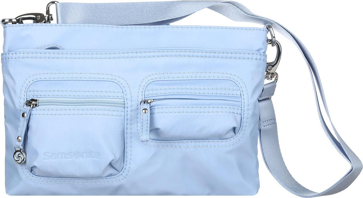 Сумка женская Samsonite, цвет: голубой. 5H3*310585H3*31058Стильная и практичная женская сумка Samsonite выполнена из полиамида. Изделие имеет одно основное отделение, закрывающееся на застежку-молнию. Внутри находятся мягкий карман для планшета с диагональю 9.7, два накладных открытых кармана и текстильный ремешок с карабином для ключей. Снаружи, на передней стенке расположены накладной карман на застежке-молнии и два накладных объемных кармана на застежках-молниях, на задней стенке - дополнительный накладной карман на застежке-молнии. Модель оснащена съемным регулируемым плечевым ремнем. Стильная сумка позволит вам завершить образ.