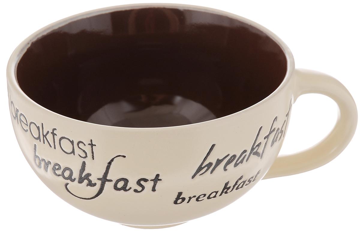 Чашка Wing Star Breakfast, цвет: бежевый, коричневый, 420 млLJ3452-1203_бежевый, коричневыйЧашка Wing Star Breakfast изготовлена из высококачественной керамики с оригинальным принтом в виде надписей. При изготовлении использовался рельефный способ нанесения декора, когда рельефная поверхность подготавливается в процессе формовки, и изделие обрабатывается с уже готовым декором. Благодаря этому достигается эффект неровного на ощупь рисунка, как бы утопленного внутрь глазури и являющегося его естественным элементом. Такая чашка прекрасно подойдет для горячих и холодных напитков. Она дополнит коллекцию вашей кухонной посуды и будет служить долгие годы. Можно использовать в посудомоечной машине и СВЧ. Диаметр чашки (по верхнему краю): 11,5 см.
