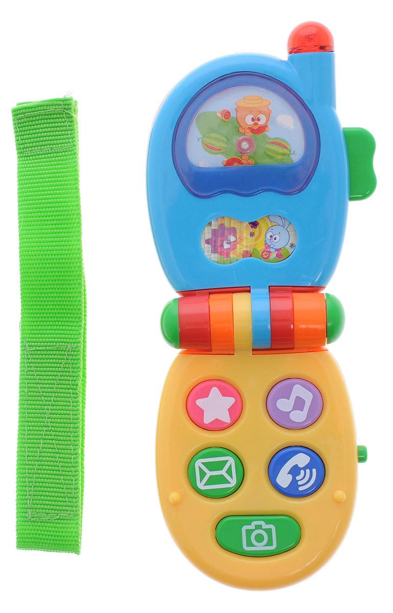 Малышарики Музыкальная игрушка Телефон цвет голубой желтыйMSH0303-005Музыкальная игрушка Малышарики Телефон со световыми и звуковыми эффектами обязательно порадует малыша. На поверхности телефона малыш обнаружит множество функциональных кнопок и подвижную картинку, на которой изображены популярные герои мультфильма. Выполненная в приятной цветовой гамме, игрушка развивает логическое мышление, концентрацию внимания, мелкую моторику и слуховое восприятие. Необходимо купить 2 батарейки типа ААА (не входят в комплект).