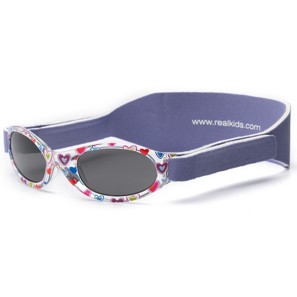 Real Kids Shades 024PURPHRTS Очки солнцезащитные детские024PURPHRTSБезопасные детские солнцезащитные очки Real Kids Shades Shades серии My First Shades, для детей с рождения до двух лет (обхват головы от 41 до 47 см). Обеспечивают 100% защиту от ультрафиолетовых лучей (UVA и UVB) до 400 нанометров, категория защиты 3. Хит продаж, потому что очень удобны. Компания Real Kids Shades Shades (США) создает детские солнцезащитные очки ориентируясь на подвижный образ жизни детей и с учетом того, что детские глаза более уязвимы, сильнее страдают от воздействия ультрафиолетовых лучей. Отдельное внимание уделено тому, чтобы очки хорошо сидели. Малыши могут кататься на качелях, висеть вверх ногами, плавать и играть без боязни того, что очки слетят в самый неподходящий момент. Эластичный регулируемый неопреновый ремешок не пережимает голову, очки прочно держатся и не создают неудобств ребенку, в них можно даже спать. Очки серии My First Shades не тонут, так что даже в воде они не потеряются. Не бьются. Профессиональные линзы и оправа из поликарбоната....