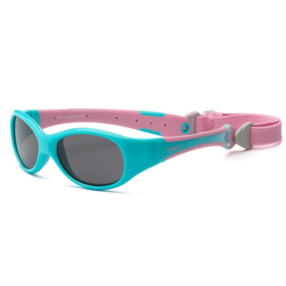 Real Kids Shades Очки солнцезащитные детские от 0 месяцев цвет розовый бирюзовый0EXPAQPKБезопасные солнцезащитные очки для детей с рождения Real Kids Shades 0+ 100% защита детских глаз от ультрафиолетовых лучей (UVA и UVB). Гибкая оправа Flex FitТМ, с дужками обтекаемой формы снижает до минимума риск повреждений детских глаз при одевании. Очки не сломаются, если ребенок случайно сядет на них, или потянет дужки в разные стороны Форма очков минимизирует воздействие периферийного света. Ударопрочные, травмобезопасные поликарбонатные линзы. Регулируемый, эластичный, съемный ремешок в комплекте. Очки хорошо держатся и не создают неудобств ребенку. Дети в очках Реал Кидс могут даже спать. Созданы с учетом подвижного образа жизни ребенка, Отдельное внимание уделено тому, чтобы очки хорошо сидели. Малыши могут кататься на качелях, висеть вверх ногами, плавать и играть без боязни того, что очки слетят в самый неподходящий момент. Безопасность: не содержат свинец, бисфенол-А, фталаты. Соответствуют всем международным нормам безопасности EC, Австралии, Америки, России.