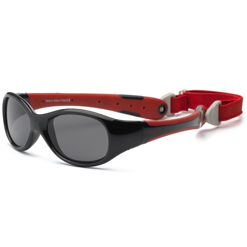 Real Kids Shades Очки солнцезащитные детские от 0 месяцев цвет черный красный0EXPBKRDБезопасные солнцезащитные очки для детей с рождения Real Kids Shades 0+ 100% защита детских глаз от ультрафиолетовых лучей (UVA и UVB). Гибкая оправа Flex FitТМ, с дужками обтекаемой формы снижает до минимума риск повреждений детских глаз при одевании. Очки не сломаются, если ребенок случайно сядет на них, или потянет дужки в разные стороны Форма очков минимизирует воздействие периферийного света. Ударопрочные, травмобезопасные поликарбонатные линзы. Регулируемый, эластичный, съемный ремешок в комплекте. Очки хорошо держатся и не создают неудобств ребенку. Дети в очках Реал Кидс могут даже спать. Созданы с учетом подвижного образа жизни ребенка, Отдельное внимание уделено тому, чтобы очки хорошо сидели. Малыши могут кататься на качелях, висеть вверх ногами, плавать и играть без боязни того, что очки слетят в самый неподходящий момент. Безопасность: не содержат свинец, бисфенол-А, фталаты. Соответствуют всем международным нормам безопасности EC, Австралии, Америки, России.