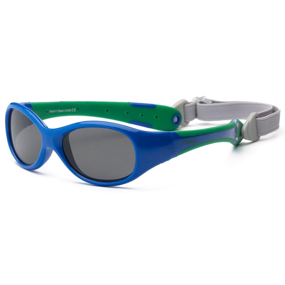Real Kids Shades Очки солнцезащитные детские от 0 месяцев цвет синий зеленый0EXPRYGRБезопасные солнцезащитные очки для детей с рождения Real Kids Shades 0+ 100% защита детских глаз от ультрафиолетовых лучей (UVA и UVB). Гибкая оправа Flex FitТМ, с дужками обтекаемой формы снижает до минимума риск повреждений детских глаз при одевании. Очки не сломаются, если ребенок случайно сядет на них, или потянет дужки в разные стороны Форма очков минимизирует воздействие периферийного света. Ударопрочные, травмобезопасные поликарбонатные линзы. Регулируемый, эластичный, съемный ремешок в комплекте. Очки хорошо держатся и не создают неудобств ребенку. Дети в очках Реал Кидс могут даже спать. Созданы с учетом подвижного образа жизни ребенка, Отдельное внимание уделено тому, чтобы очки хорошо сидели. Малыши могут кататься на качелях, висеть вверх ногами, плавать и играть без боязни того, что очки слетят в самый неподходящий момент. Безопасность: не содержат свинец, бисфенол-А, фталаты. Соответствуют всем международным нормам безопасности EC, Австралии, Америки, России.