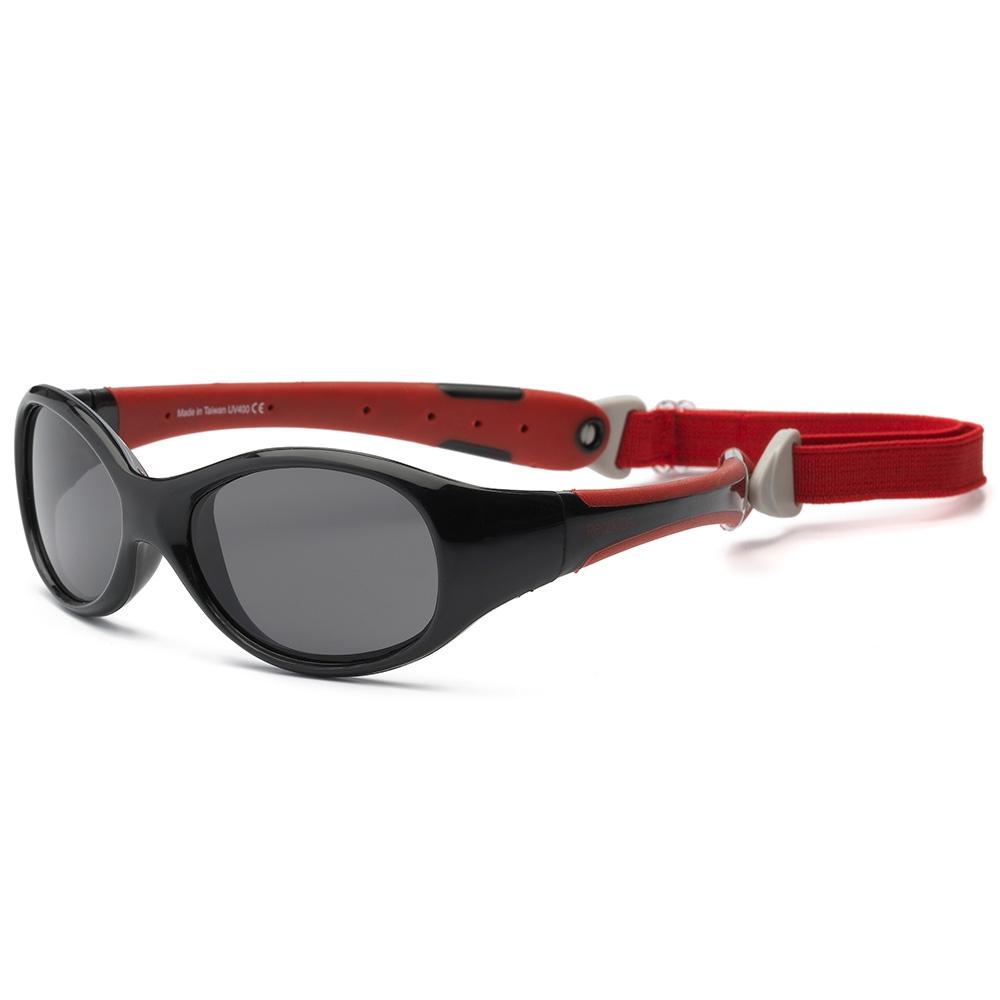 Real Kids Shades Explorer Очки солнцезащитные детские от 2 лет цвет черный красный2EXPBKRDБезопасные солнцезащитные очки для детей Real Kids Shades от 2-х лет и старше 100% защита детских глаз от ультрафиолетовых лучей (UVA и UVB). Гибкая оправа Flex FitТМ, с дужками обтекаемой формы снижает до минимума риск повреждений детских глаз при одевании. Форма очков минимизирует воздействие периферийного света. Ударопрочные, травмобезопасные поликарбонатные линзы. Регулируемый, эластичный, съемный ремешок в комплекте. Очки хорошо держатся и не создают неудобств ребенку. Дети в очках Реал Кидс могут даже спать. Созданы с учетом подвижного образа жизни ребенка, Отдельное внимание уделено тому, чтобы очки хорошо сидели. Малыши могут кататься на качелях, висеть вверх ногами, плавать и играть без боязни того, что очки слетят в самый неподходящий момент. Безопасность: не содержат свинец, бисфенол-А, фталаты. Соответствуют всем международным нормам безопасности EC, Австралии, Америки, России.