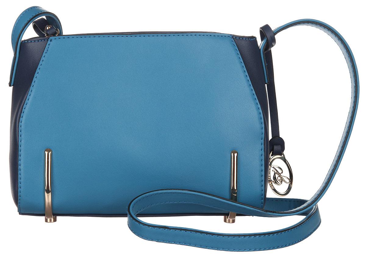 Сумка кросс-боди женская Jane Shilton, цвет: темно-синий, голубой. 20692069blueСтильная женская сумка кросс-боди Jane Shilton, выполненная из искусственной кожи, дополнена фирменным брелоком. Изделие имеет одно основное отделение, которое закрывается на застежку-молнию. Внутри находятся прорезной карман на застежке-молнии и накладной открытый карман. Снаружи, на задней стенке расположен прорезной карман на застежке-молнии. Модель оснащена регулируемым плечевым ремнем. Основание изделия защищено от повреждений металлическими ножками. Роскошная сумка кросс-боди внесет элегантные нотки в ваш образ и подчеркнет ваше отменное чувство стиля.
