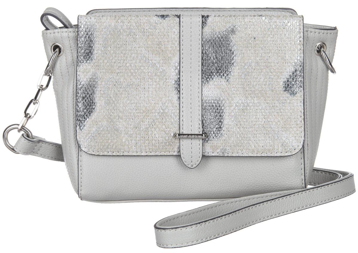 Сумка кросс-боди женская Jane Shilton, цвет: светло-серый, серый. 20592059greyСтильная женская сумка кросс-боди Jane Shilton выполнена из искусственной кожи. Изделие имеет одно отделение, закрывающееся на застежку-молнию. Внутри находится прорезной карман на застежке-молнии. Снаружи, на задней стенке и на передней стенке под клапаном с магнитной кнопкой расположены накладные карманы. Клапан оформлен принтом под змею. Модель оснащена регулируемым плечевым ремнем. Роскошная сумка кросс-боди внесет элегантные нотки в ваш образ и подчеркнет ваше отменное чувство стиля.