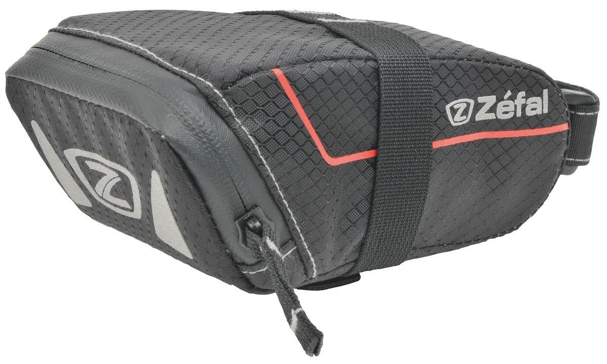 Подседельная сумка Zefal Z Light Pack S7040Подседельная сумка для велосипеда Zefal Z Light Pack S изготовлена из высококачественного текстиля (полистер). Прорезиненная молния защиты от попадания влаги внутрь. Легкая и быстрая установка на подседельный штырь и рамки седла. Zefal – старейший французский производитель велосипедных аксессуаров премиального качества, основанный в 1880 году, является номером один на французском рынке велосипедных аксессуаров. Подседельная сумка Zefal Z Light Pack S, размер S, цвет черный ОСОБЕННОСТИ: - Сумка изготовлена из полистера - Водонепроницаемая молния - Крепление на душки седла - Объем 0,5 л (16 oz) - Габариты сумки 140 х 70 х 65 мм - Вес 40гр