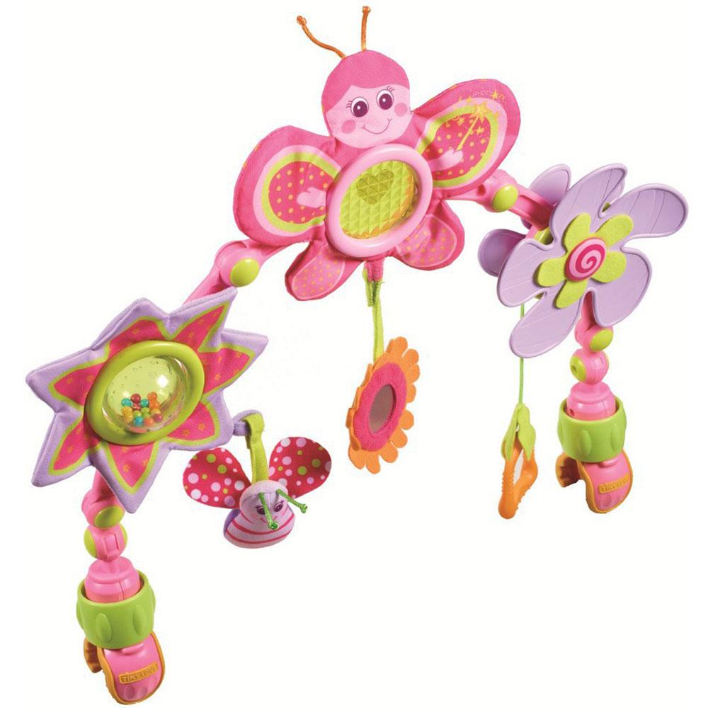 Tiny Love Дуга развивающая Моя принцесса1402605830Развивающая дуга Моя принцесса выполнена в виде дуги, на которой расположены три игрушки в виде веселой бабочки, звездочки и пропеллера. У бабочки шуршат крылышки, снизу на текстильной веревочке к ней крепится цветочек с безопасным зеркальцем в центре. В лучиках звездочки спрятан шуршащий элемент, а в центре расположен прозрачный шарик с разноцветными бусинками внутри, которые гремят при вращении шарика. Снизу к звездочке крепится симпатичный жучок. Пропеллер выполнен в виде цветочка и крутится со звуком трещотки. Снизу к пропеллеру крепится мягкий прорезыватель. Элементы дуги выполнены преимущественно в розовых и сиреневых тонах, которые так любят маленькие принцессы! Дуга имеет четыре подвижных шарнира, с помощью которых можно изменять высоту и расположение. Крепится дуга при помощи двух зажимов. Дуга Моя принцесса развивает у ребенка цветовое и звуковое восприятия, тактильные ощущения, мелкую моторику рук и координацию движений.