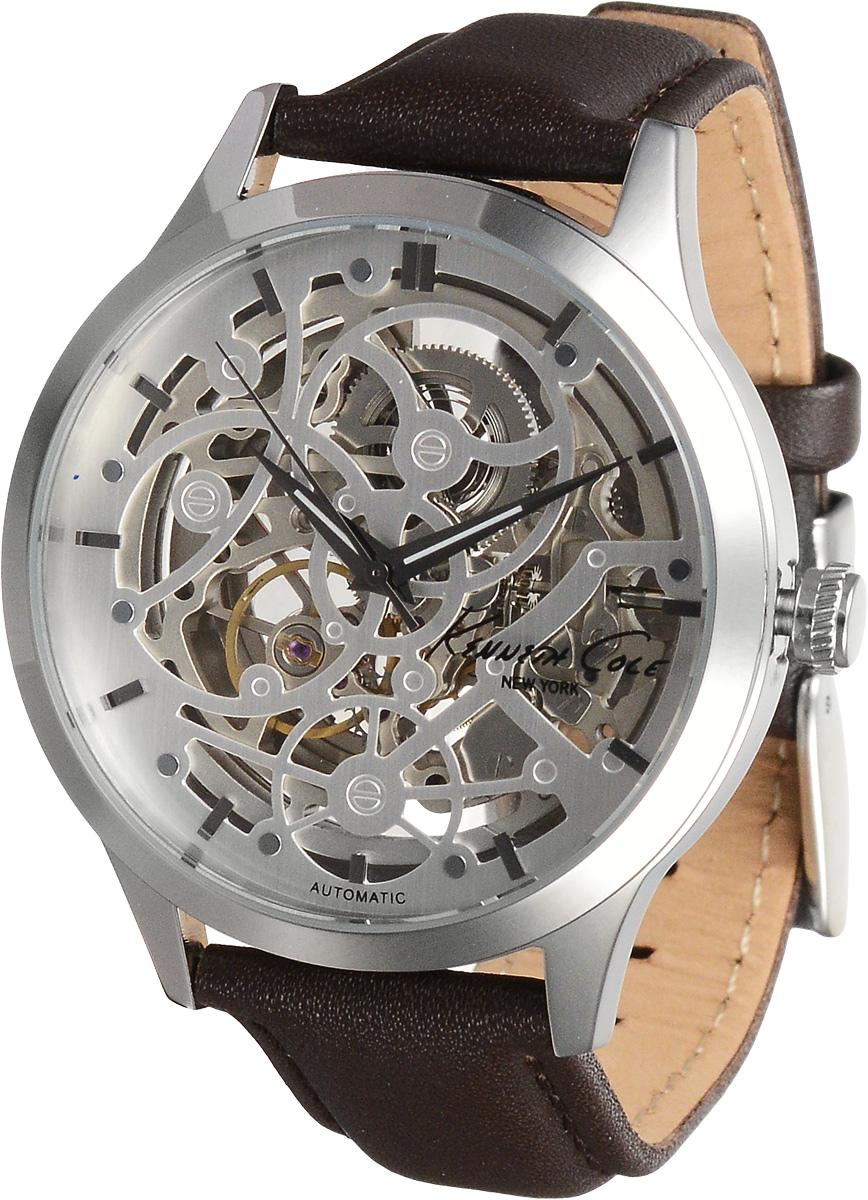 Часы наручные Kenneth Cole, цвет: коричневый, серебристый. 1002628410026284Наручные часы Kenneth Cole произведены опытными специалистами из материалов самого высокого качества на базе новейших технологий. Они оснащены точным кварцевым механизмом. Корпус часов, изготовленный из нержавеющей стали, защищен минеральным стеклом. Ремешок с классической застежкой выполнен из натуральной кожи. Прозрачный циферблат с видимым глазу механизмом оснащен отметками, а также тремя стрелками - часовой, минутной и секундной. Часы укомплектованы в фирменную коробку с названием бренда.