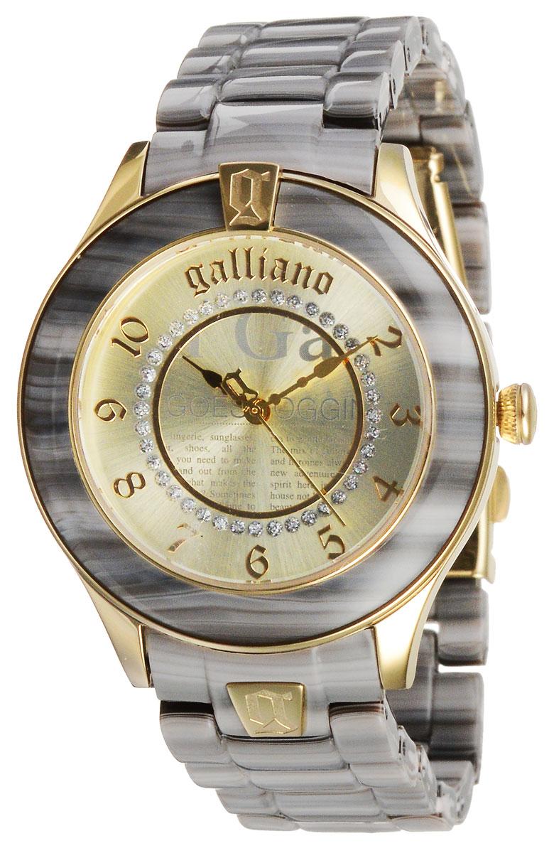 Наручные часы женские Galliano, цвет: серо-бежевый, золотистый. R2553108506R2553108506Наручные женские часы Galliano созданы для современных девушек, которые не желают потерять свою индивидуальность в городской суете. Они оснащены точным кварцевым механизмом. Водонепроницаемый корпус выполнен из высококачественной нержавеющей стали, безель - из пластика. Корпус часов защищен минеральным стеклом. Циферблат круглой формы декорирован газетным принтом и украшен блестками, имитирующими стразы. Циферблат оснащен арабскими цифрами и имеет три стрелки - часовую, минутную и секундную. Браслет часов, выполненный из высококачественного пластика, оснащен застежкой клипсой. Изделие укомплектовано в фирменную коробку с названием бренда. Часы Galliano благодаря своему великолепному дизайну и качеству исполнения станут главным акцентом вашего образа.