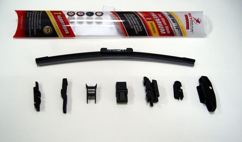 Щетка стеклоочистителя Skybear Premium, бескаркасная, 35 см, 1 шт701140Бескаркасная щетка стеклоочистителя Skybear Premium прекрасно очищает в любую погоду. Тефлоновое покрытие обеспечивает превосходную очистку и увеличивает срок эксплуатации. Щетка обладает аэродинамическим дизайном. Подходит к 95% автомобилей. В комплект входят 7 адаптеров.