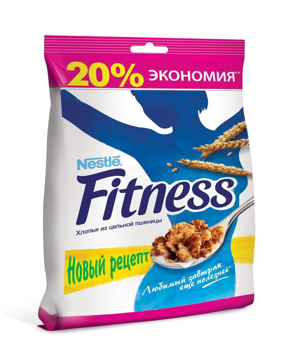 """Готовый завтрак Nestle Fitness """"Хлопья из цельной пшеницы"""" - идеальный вариант готового завтрака для современной женщины: легкий, вкусный и полезный. В одной порции (30 г) хлопьев Fitness содержится: - 16,1 г цельного зерна пшеницы, которое является важной частью сбалансированного рациона; - клетчатка; - минимум жиров (всего 0,7 г); - витамины и минералы, включая кальций и железо. В хлопьях также содержатся отруби, которые помогают регулировать пищеварение, очищать организм и поддерживать нормальный вес. Хлопья Nestle Fitness сделают каждый ваш завтрак не только полезным, но и по-настоящему вкусным."""