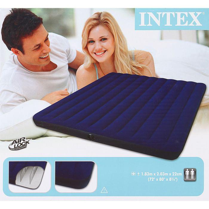 Матрас надувной Intex Classic Downy King 183х203х22 см, цвет: синий. 68755589409Матрас надувной Classic Downy King имеет привлекательный темно-синий цвет. Особенность матраса - наилучшее соотношение цена-качество. При минимальной стоимости изделия вы получаете комфортную дополнительную кровать для дома и прочный матрас для туризма. Флокированное (велюровое) покрытие не позволит скользить простыне. Внутреннее устройство матраса представляет собой оболочку с перегородками для плавного перетекания воздуха. Материал надувного матраса - прочный высококачественный и водонепроницаемый винил. Матрас оснащен клапанами 2 в одном, позволяющими быстро спустить или накачать воздух, используя любой насос фирмы Intex. Насос не входит в комплектацию. Матрас можно использовать как дома, так и в путешествиях. При покупке данной модели вы получите качественный отдых и сон для вас и ваших гостей! Матрас надувной Classic Downy King 183х203х22 см
