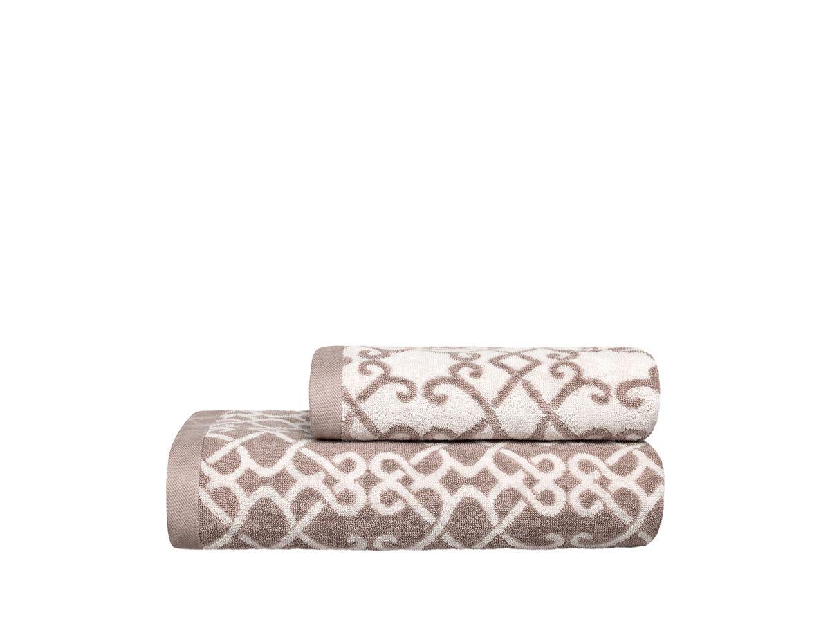 Полотенце Togas Монограмма, цвет: бежевый, 50 х 100 см10.00.01.1008Полотенце Togas Монограмма невероятно гармонично сочетает в себе лучшие качества современного махрового текстиля. Безупречные по качеству, экологичное полотенце из 40% хлопка и 60% модала идеально заботится о вашей коже, особенно после душа, когда вы расслаблены и особо уязвимы. Деликатный дизайн полотенца Togas «Монограмма» - воплощение изысканной простоты, где на первый план выходит качество материала. Невероятно мягкое волокно модал, превосходящее по своим свойствам даже хлопок, позволяет улучшить впитывающие качества полотенца и делает его удивительно мягким. Модал - это 100% натуральное, экологически чистое целлюлозное волокно. Оно производится без применения каких-либо химических примесей, поэтому абсолютно гипоаллергенно. Полотенце Togas Монограмма, обладающее идеальными качествами, будет поднимать вам настроение.