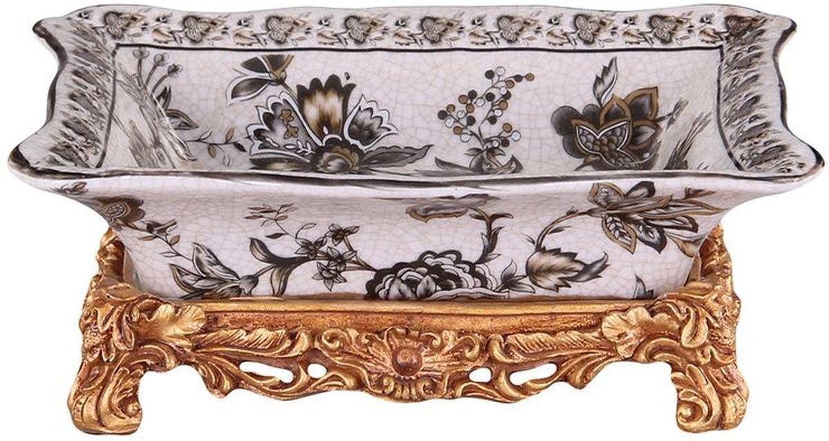 Конфетница 20 см PATRICIAIM10-0412Конфетница выполнена из керамики с эффектом состаренности. Изделие имеет овальную форму. Подставка изготовлена из полимерного материала имитирующего бронзу. Вся поверхность изделия украшена цветочным декор.
